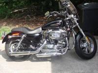 A 2011.... 1200 Custom Harley Davidson Sportster