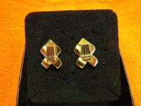 A pair of Harley Davidson post back earrings. Ribbon