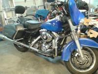 This is a 2006 Harley Davidson Electra-Glide Custom