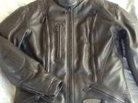 In beautiful condition, women's leather jacket with
