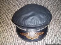 Preowened but in very good condition. Leather cap with
