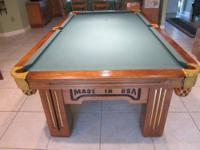 This is an 8' pool table made by Olhausen for Harley