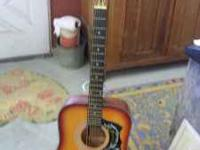 Harmony Acoustic Guitar with Hummingbird Pick Guard