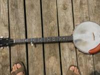 Harmony open back banjo. Plays fine, well used, has new