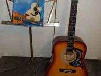 guitar and music book with music stand asking 80.00 the