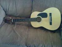 Junior Guitar with shoulder strap and plastic carring
