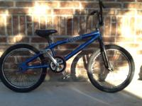 A haro bmx bike with various components. the stickers