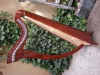 French made Celtic lever harp made by Camac. The model