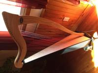 My harp was made by Dusty Strings. It's a Ravenna 34