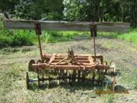 6 1/2 FOOT HEAVY DUTY FORD MAC HARROW WITH DRAG. PH: