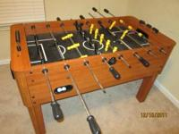 This is a Harvard Foosball Table with (4) balls and (2)