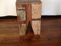 Reclaimed boat wood side table purchased from Harvest
