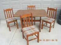 This is a wood formica top table and four wood
