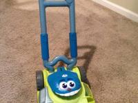 1) Hasbro PlaySkool Mower. - $10.  Push it around and