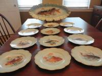 Here is a set of 12 Haviland France Porcelain Fish