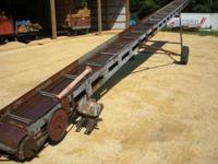 30 FOOT CONVEYOR ON TRANSPORT HAS A WIDE TROUGH THAT