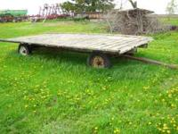 have a hay rack with running gear for sale,has newer