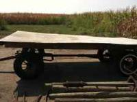 Antique rack wagon with spoked wheels. Good wood