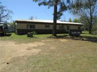 This 3br. 2 ba. mobile home sits on 4 lovely acres. It