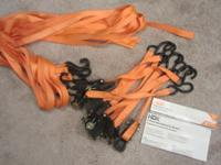 I have 2 four-packs of these like-new tie-downs. Used