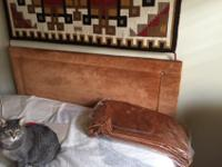 This mid-century modern velour full size headboard with