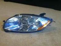 2008 Mitsubishi Eclipse driver side stock headlight. In