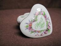 Selling this 2 piece heart shaped porcelain inscribed