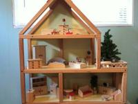 HearthSong dollhouse, furniture, dolls. Purchased in