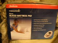 A Brand new never used Queen heated mattress pad 300