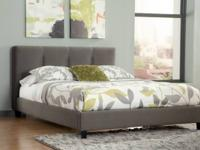 With a sleek fully upholstered system bed with tufted