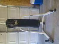 100 lb heavy bag and stand in excellent shape! Will