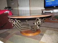 42 inch coffee table with two matching endtables. Paid