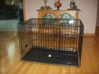 Heavyweight wire dog crate, features 2 doors. Easy to