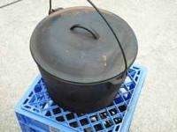 Hello, This is a vintage cast iron dutch oven cookpot