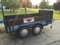 HEAVY DUTY, CUSTOM BUILT, DUAL AXLE 5' X 10' FLAT BED