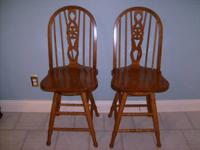 Great pair of Oak Bar Stools. Sturdy and created to