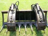 GOOD USED HEAVY DUTY RAKE/GRAPPLE ATTACHMENT. CONTACT