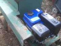 Heavy duty tow behind shredder with a new motor. It has