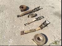 I have three heavy duty tie down straps. I used them to