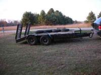 Heavy Duty Trailer designed for a bobcat or a tractor,
