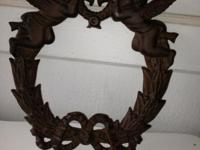 This is a heavy iron wreath with 2 cherubs or angels,