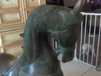 "37"" H 31"" L 12"" W antique horse statue is made of"