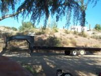 This is a heavy duty made trailer. Its deck is 24 foot