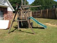 Sturdy wooden swing set. Can be dismantled down to 3-4