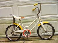 Quite an unusual bicycle for a growing family, this