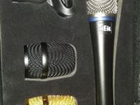 Used only once. Great vocal mic! Low handling noise,