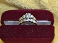 Retail cost, $6,500. 18kt white-gold bridal set using a