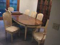 Formal dining room table with pads and 8 chairs, 6 side