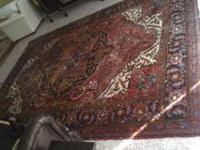 "Heriz Hand Knotted Persian Rug. Size is 7'10"" X 11'3""."
