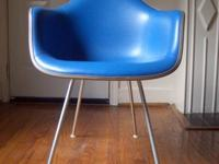 Here we have a beautiful Eames DAR shell chair for